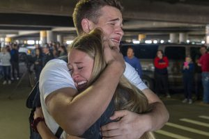 Coronavirus brings hundreds of LDS missionaries back to Utah. See photos of emotional reunions.