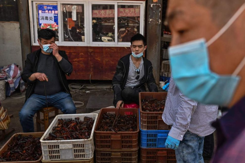 China revises up Wuhan coronavirus death toll by 1,290 to 3,869 days after Donald Trump accused Beijing of a cover up