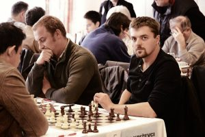Chess champ's YouTube podcast taken down for referring to 'black against white'