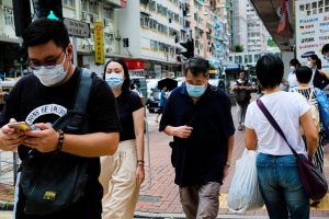 Hong Kong hit by THIRD wave of coronavirus as city vows to boot out any foreigners they consider 'high risk'