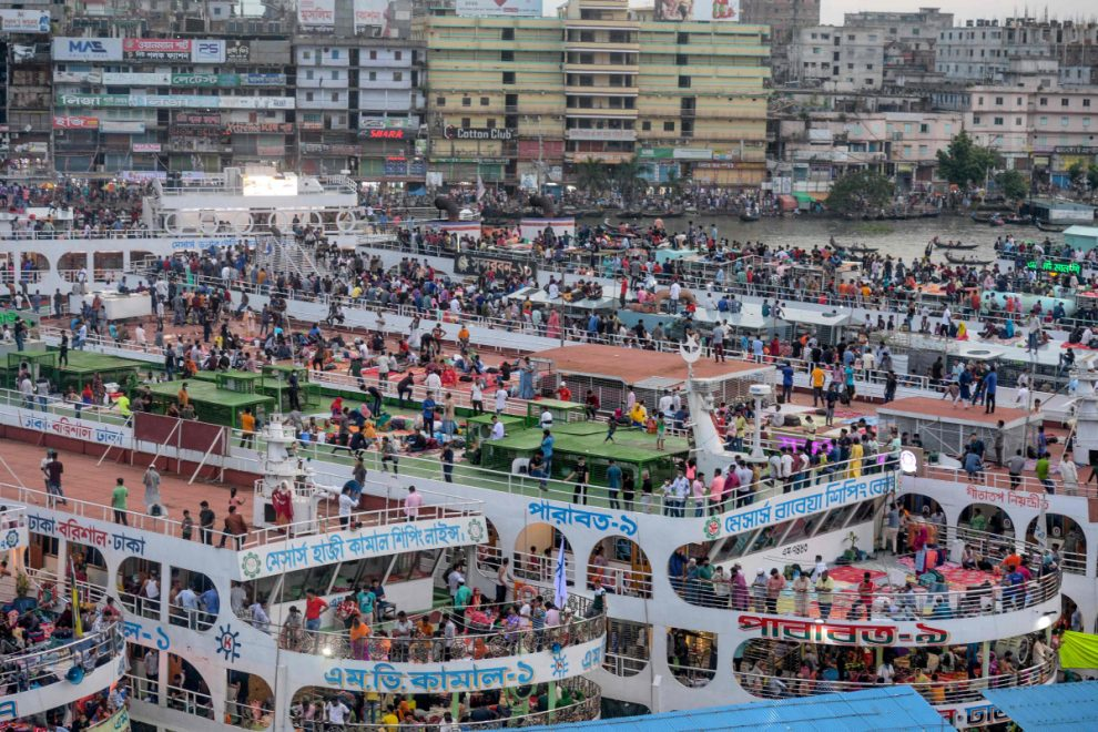 Stunning Eid pics around the world with bustling cattle market, packed ferries and mosques being made Covid-secure
