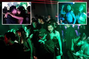 Chinese clubbers dance in Wuhan disco as coronavirus ground zero has 'NO recorded cases' just as second wave hits UK