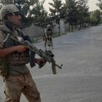 Taliban militants storm TV and radio stations as they tighten grip on key Afghan city